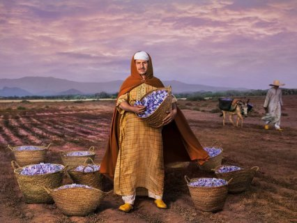guy with buckets of saffron